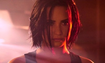 Demi Lovato Previews Action-Packed 'Confident' Music Video
