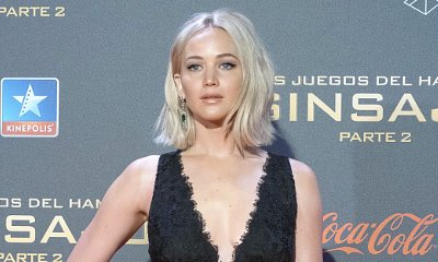 Video: Jennifer Lawrence Falls in Floor-Length Dress at 'Hunger Games' Premiere in Madrid