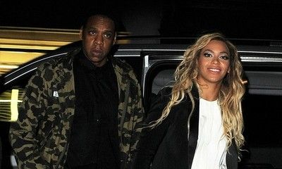 Beyonce Steps Out With Jay-Z Wearing Bright Yellow Pants and Tiny Lemon Sticker on Her Phone