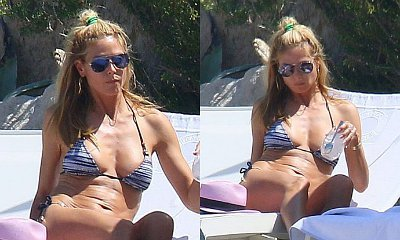 Heidi Klum Shows Off Amazing Bikini Body While Tanning in France