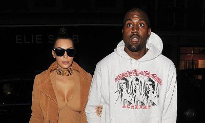 Kim Kardashian Shows Off Her Curves in Cleavage-Baring Dress During Lunch With Kanye West