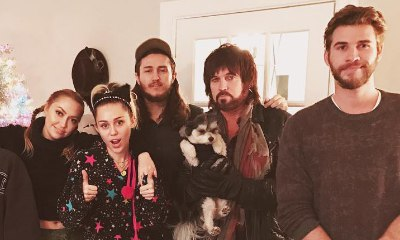 Liam Hemsworth Is Detached From Miley Cyrus in Recent Family Portrait, Expert Says
