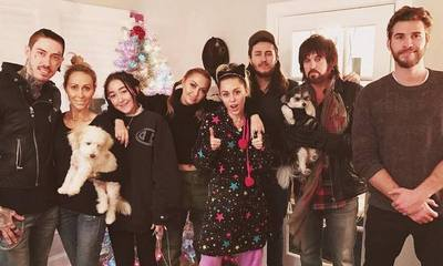 Liam Hemsworth Joins Miley Cyrus and Her Family for Early Christmas Party