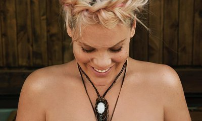 Heavily Pregnant Pink Poses Topless and Bares Her Baby Bump
