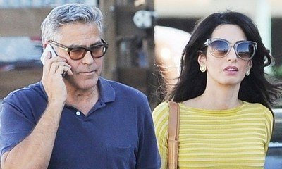 George and Amal Clooney Are 'Having a Blast Coming Up With Baby Names'