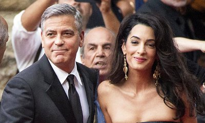 Amal Shows Off Baby Bump in Form-Fitting Gown as She Supports George Clooney at Cesar Awards