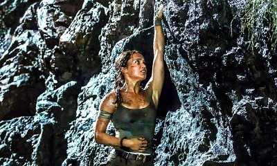 Lara Croft Dangling Off a Cliff in New 'Tomb Raider' Photo