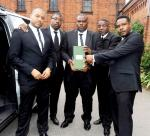 Amy Winehouse's Bodyguards Take a Picture With Her Ashes