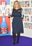 Adele Wins Big at 2012 BRIT Awards, Flips the Bird on Stage