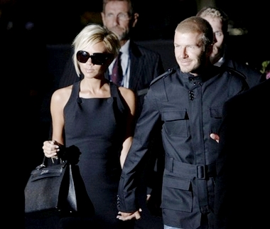 Becks and Posh Arrive in America All Smiles