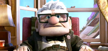 Grumpy Carl Fredricksen sits down inside his flying house in 'Up'