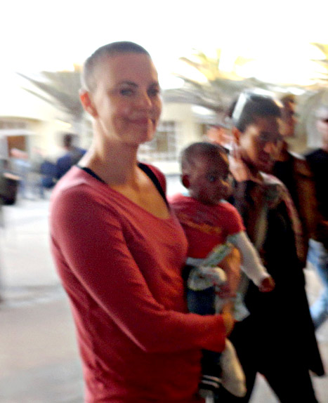 Charlize Theron Debuts Shaved Head in Namibia