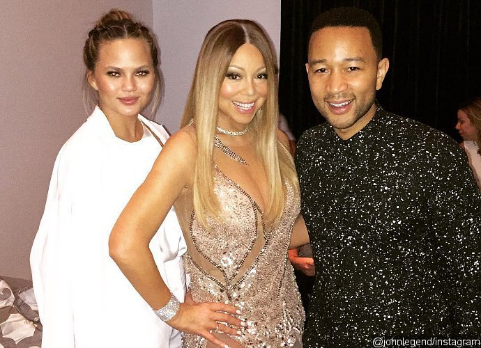 Chrissy Teigen Screams Out Loud When Mariah Carey Takes John Legend on Stage at Her Concert
