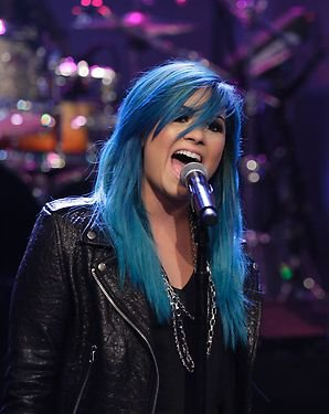 http://www.aceshowbiz.com/images/news/demi-lovato-debuts-new-blue-hair-while-performing-neon-lights-on-jay-leno-s-show.jpg