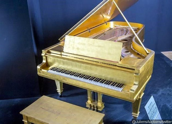 Elvis Presley's Gold Piano and Beatles Drum Skin Set for Auction