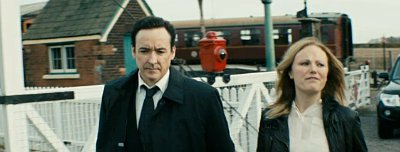 John Cusack Is Protecting Malin Akerman in First 'Numbers Station' Trailer