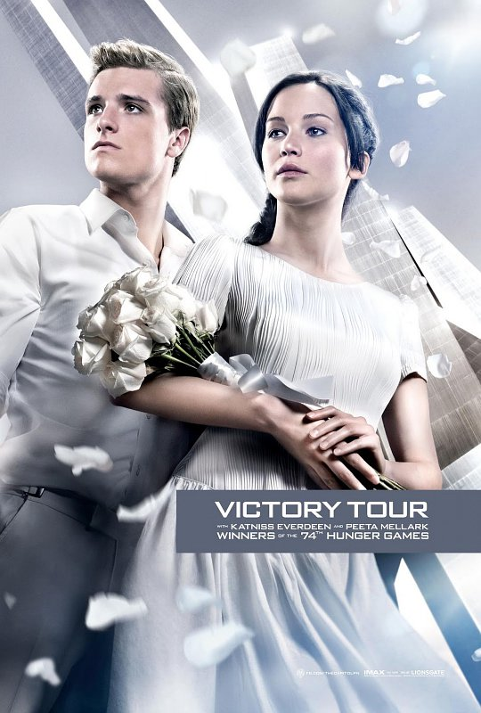 Katniss and Peeta Are Glowing for Their Victory Tour in New 'Catching Fire' Poster