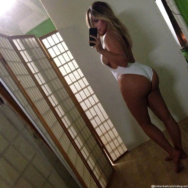 Kim Kardashian Shows Off Post-Baby Body in White Swimsuit