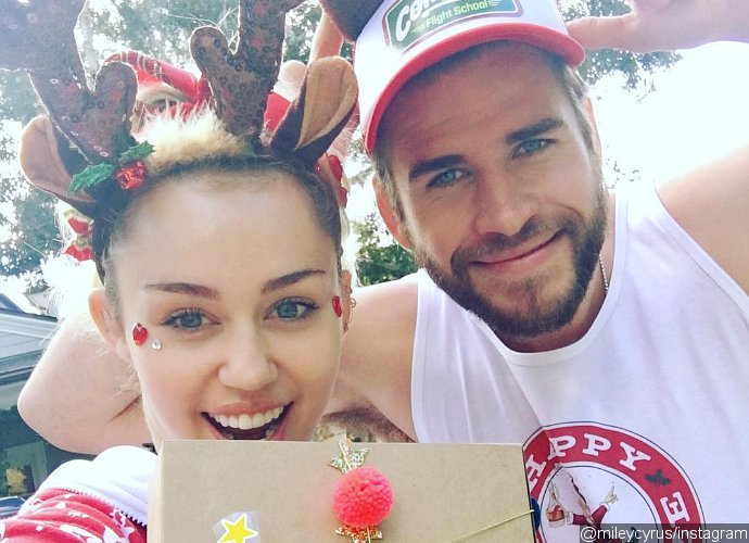 Foto: Miley Cyrus and Liam Hemsworth Make Rare Appearance Together at 'Thor: Ragnarok' Premiere