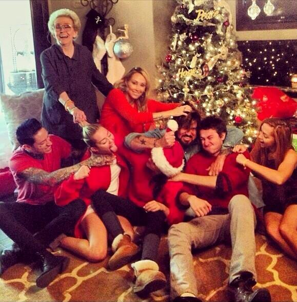 Miley Cyrus Shares Photo of 'Annual Family Fist Fight' on Christmas