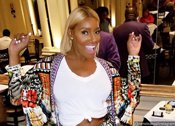 NeNe Leakes Brings Up Kim Zolciak Cockroach Drama to Halloween Party With Her Costume