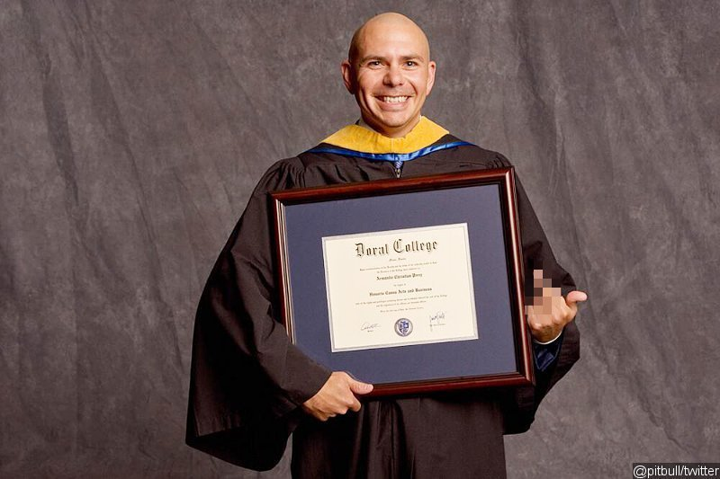 Pitbull Receives Honorary Degree, Flashes Middle Finger in Photo