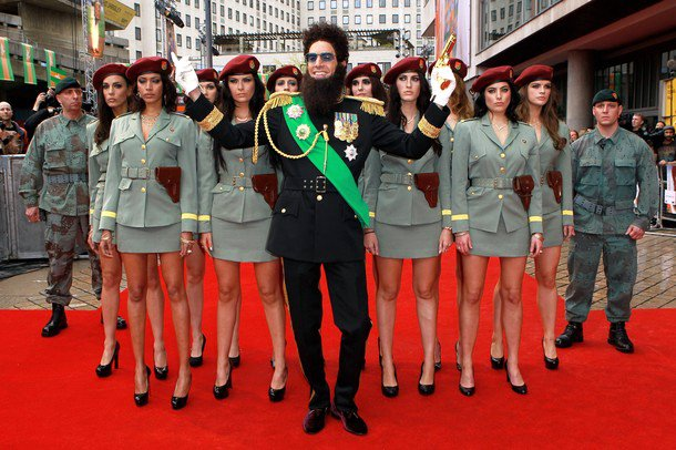 Sacha Baron Cohen Aims Gun, Gets Surrounded by Sexy Ladies at 'Dictator' U.K. Premiere