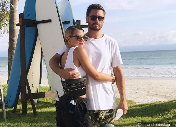 Scott Disick and Sofia Richie Continue to Pack on PDA Aboard Private Jet