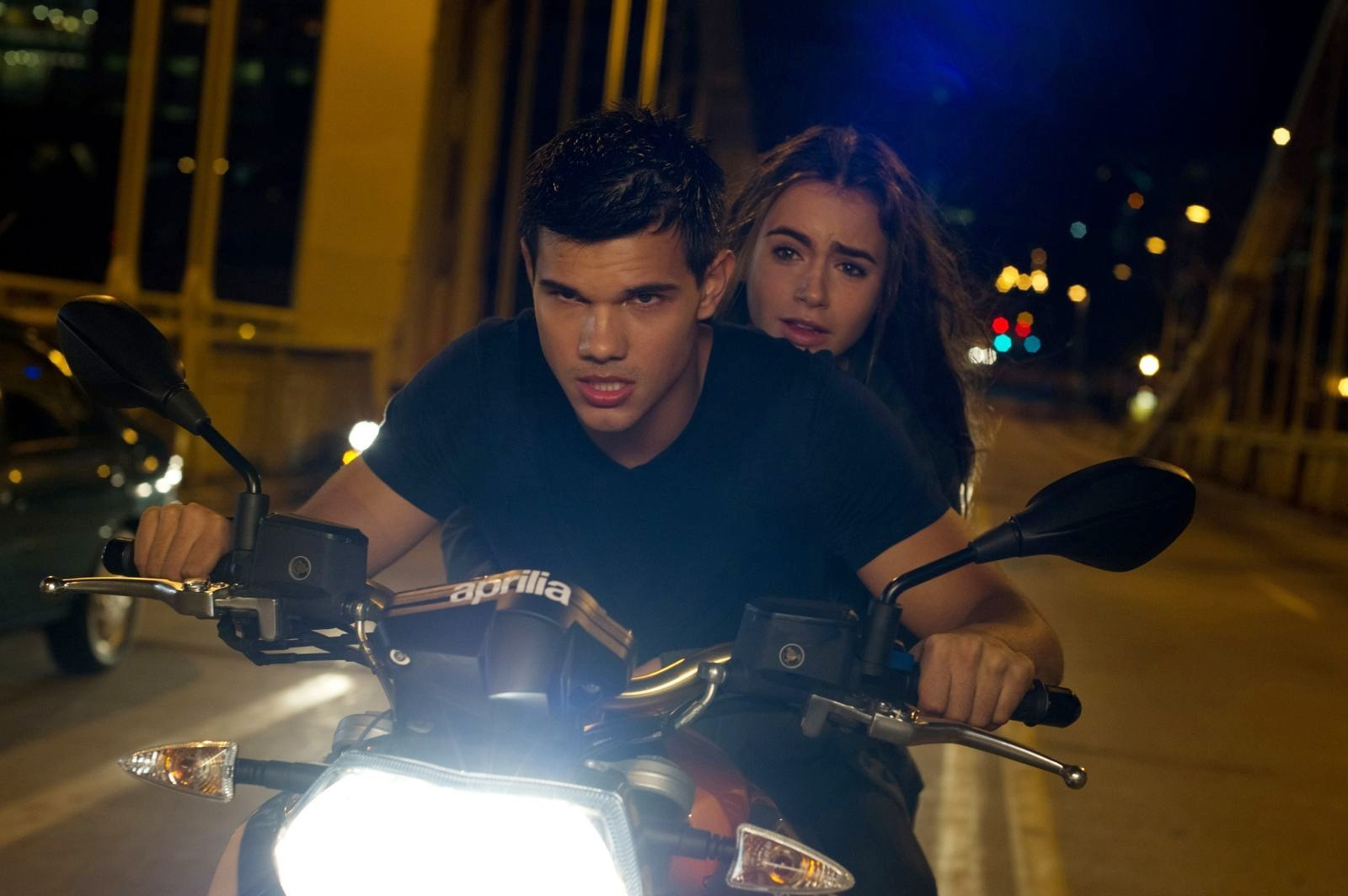 Taylor Lautner stars as Nathan and Lily Collins stars as Karen in Lionsgate Films' Abduction (2011)