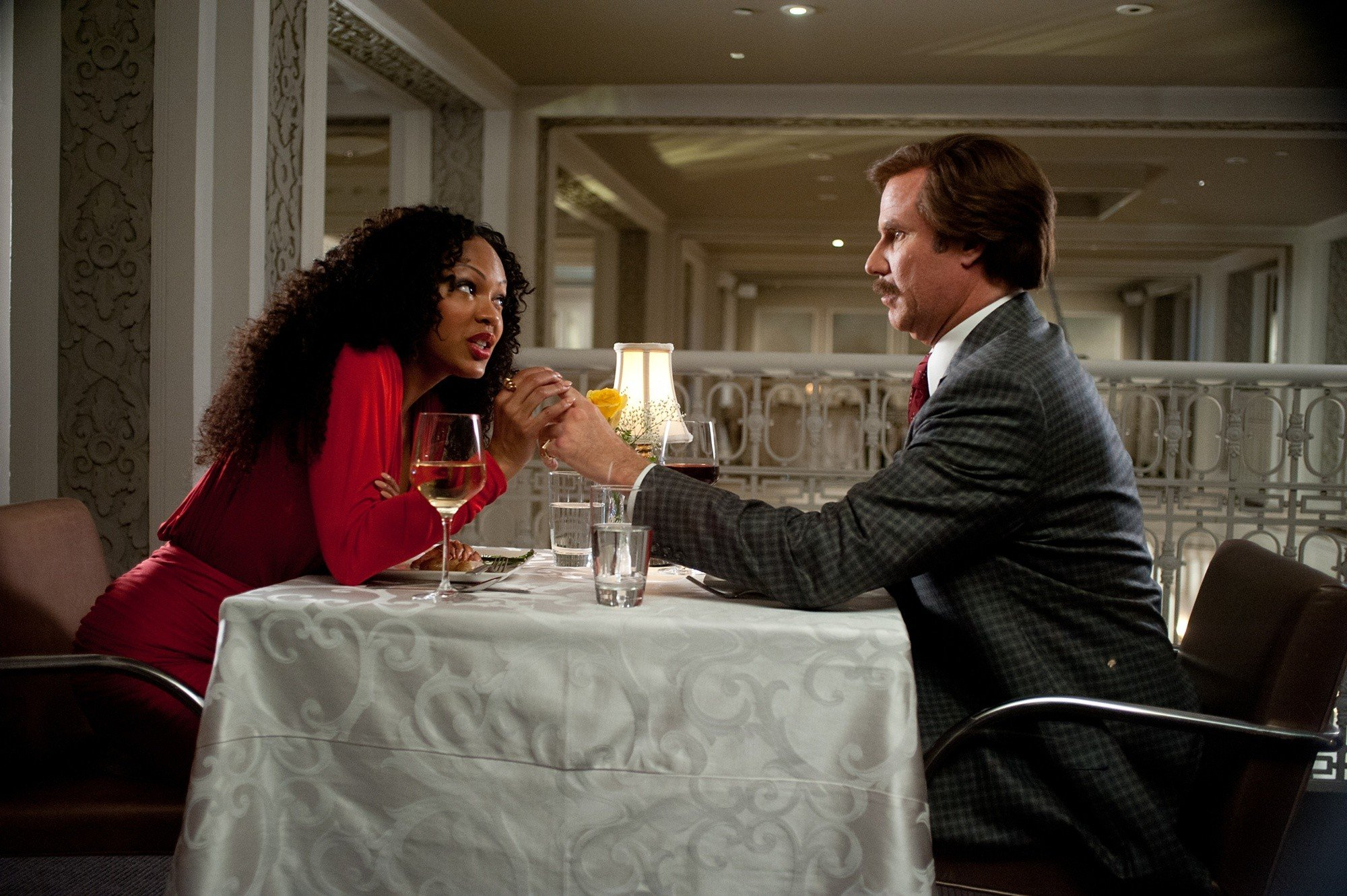 Meagan Good stars as Linda Jackson and Will Ferrell stars as Ron Burgundy in Paramount Pictures' Anchorman: The Legend Continues (2013)