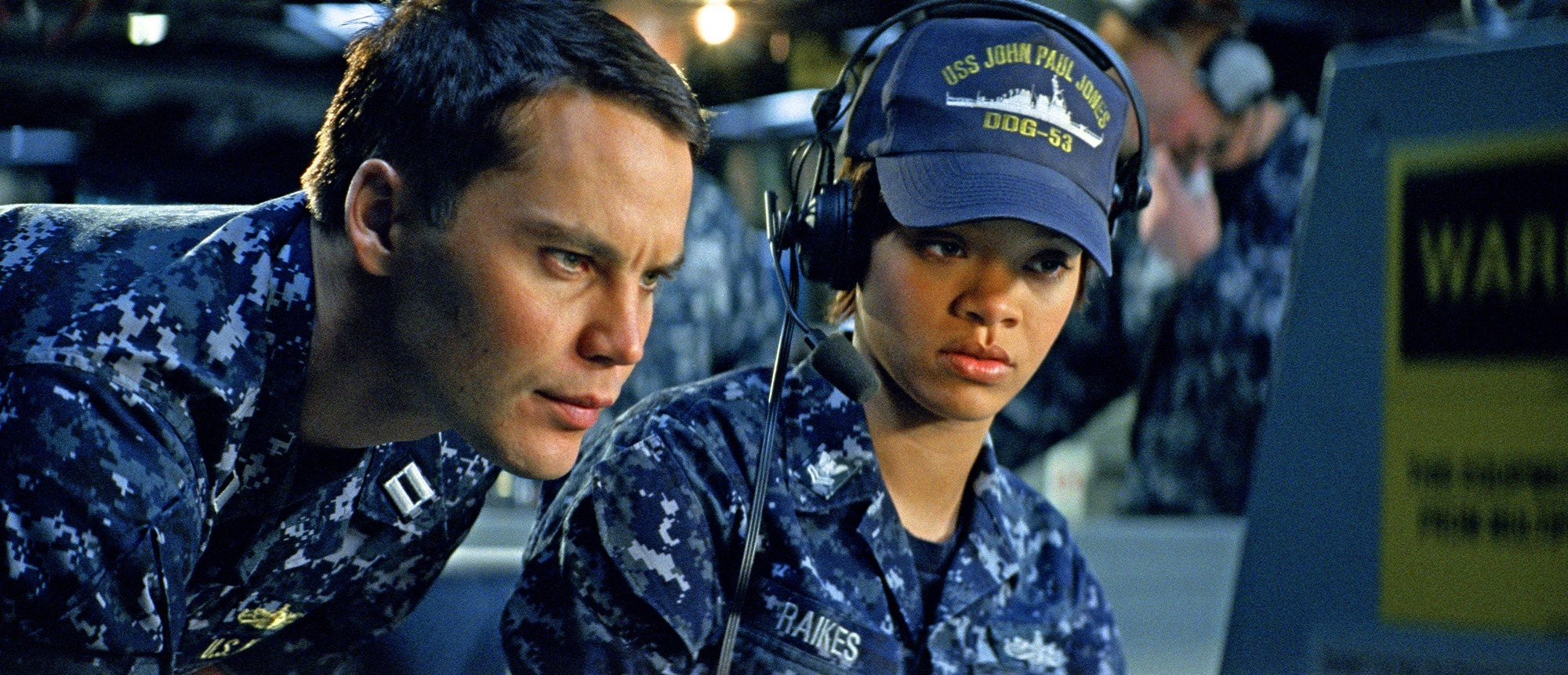 Taylor Kitsch stars as Alex Hopper and Rihanna stars as Raikes in Universal Pictures' Battleship (2012)