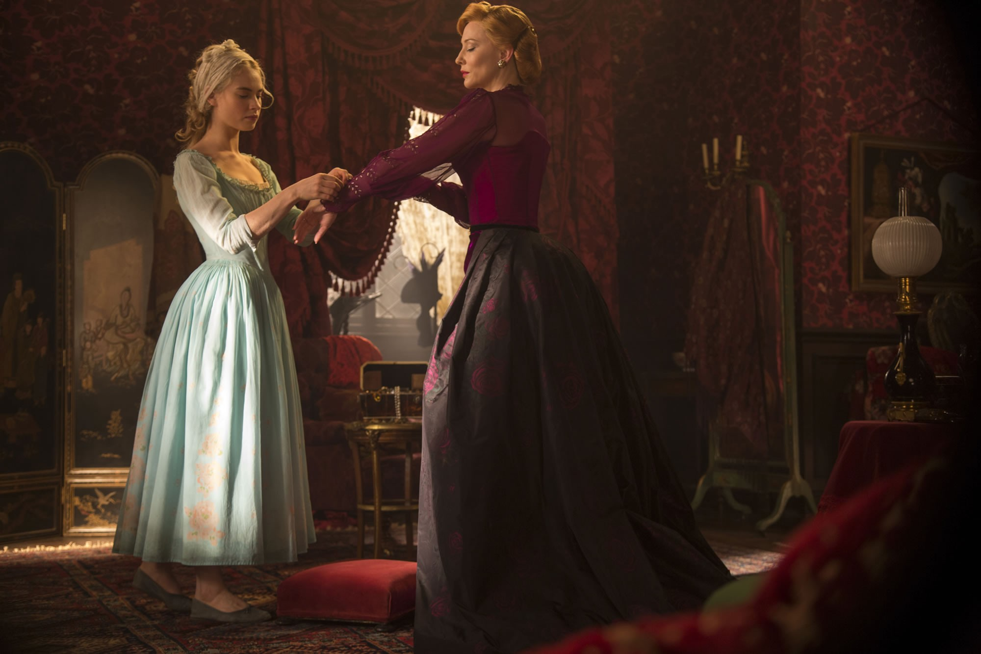 Lily James stars as Cinderella and Cate Blanchett stars as Lady Tremaine in Walt Disney Pictures' Cinderella (2015). Photo credit by Jonathan Olley.