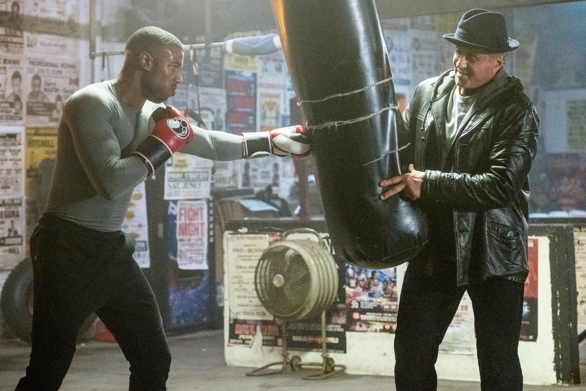 Michael B. Jordan stars as Adonis Johnson and Sylvester Stallone stars as Rocky Balboa in MGM's Creed II (2018)