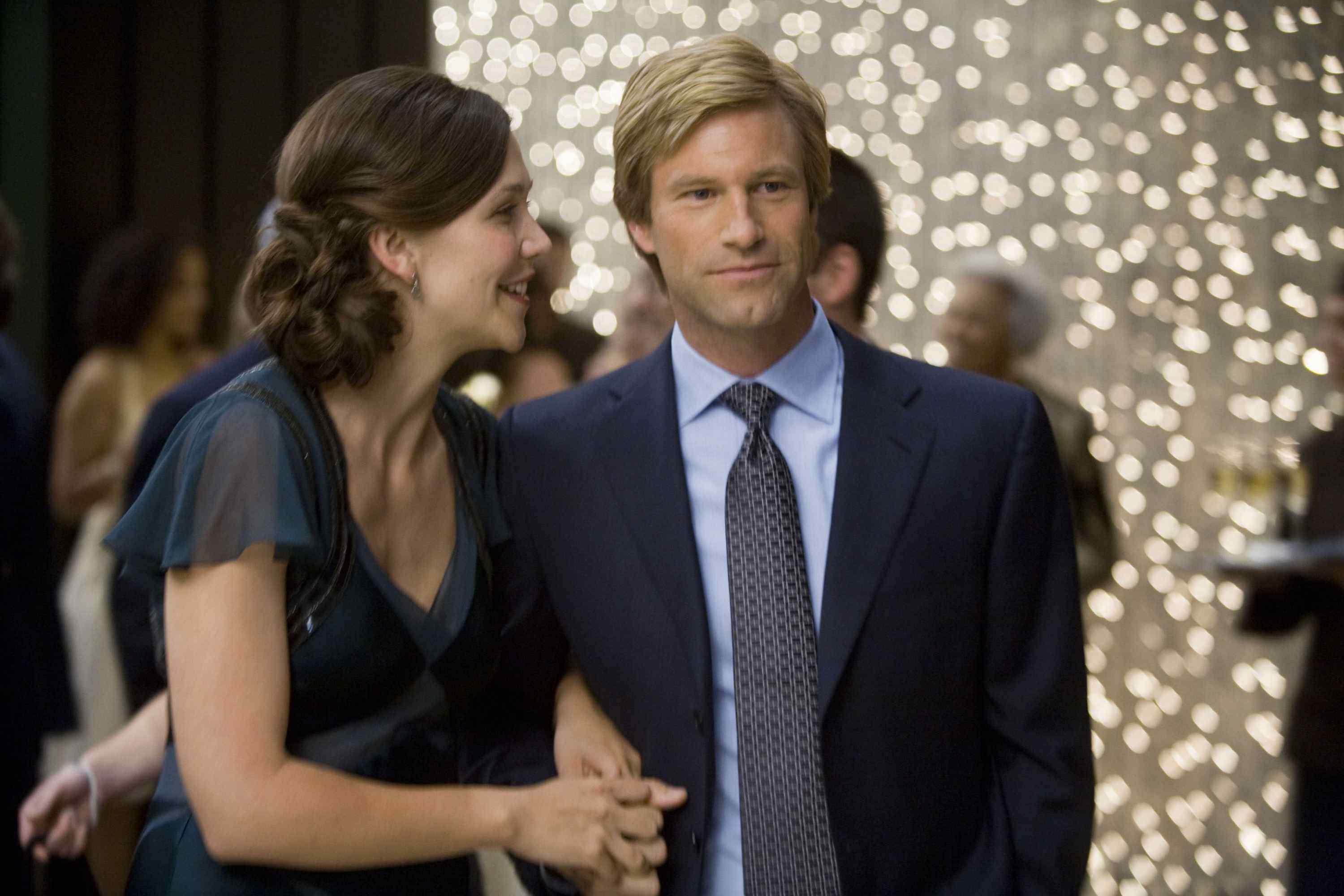 MAGGIE GYLLENHAAL stars as Rachel Dawes and AARON ECKHART stars as Harvey Dent in Warner Bros. Pictures' and Legendary Pictures' action drama
