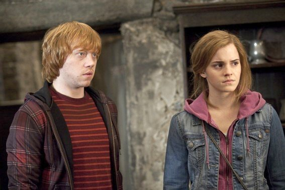 Rupert Grint stars as Ron Weasley and Emma Watson stars as Hermione Granger in Warner Bros. Pictures' Harry Potter and the Deathly Hallows: Part II (2011)