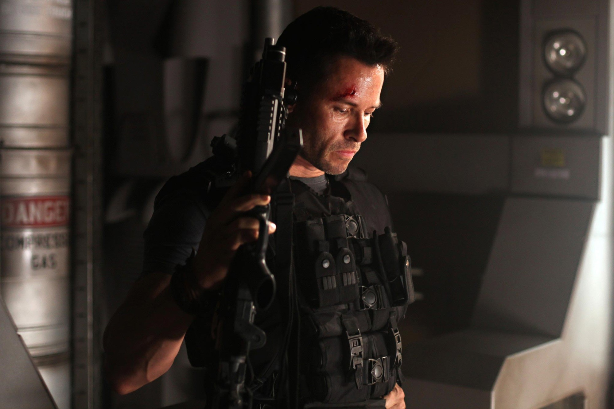 Guy Pearce stars as Snow in Europa Corp.'s Lockout (2012)