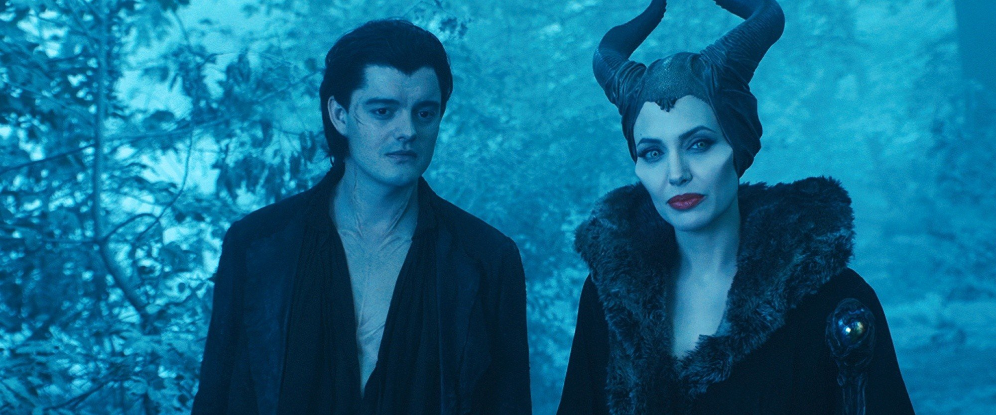 Sam Riley stars as Diaval and Angelina Jolie stars as Maleficent in Walt Disney Pictures' Maleficent (2014)