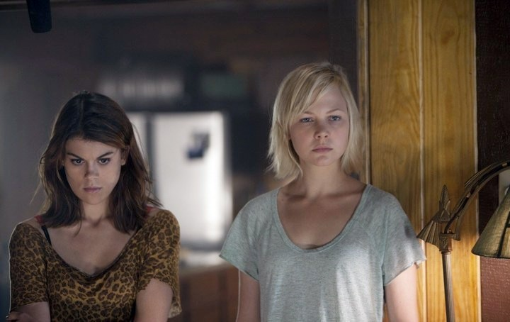 Lindsey Shaw stars as Amber and Adelaide Clemens stars as Emma in Anchor Bay Films' No One Lives (2013)