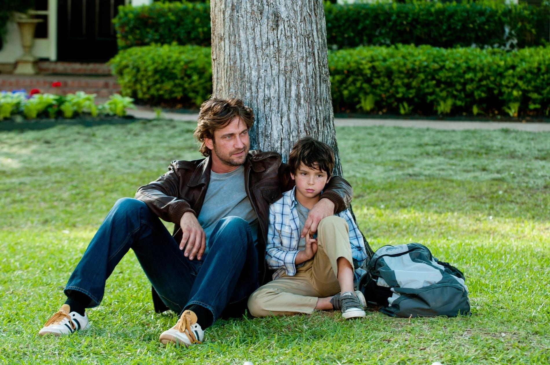 Gerard Butler stars as George and Noah Lomax stars as Lewis in FilmDistrict's Playing for Keeps (2012)