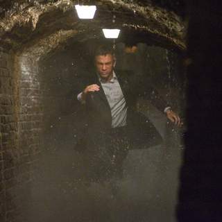 James Bond (DANIEL CRAIG) charges through the underground cisterns of Sienna in pursuit of an Mi6 traitor. Location: Pinewood Studios, Buckinghamshire, UK. Photo by: Karen Ballard.