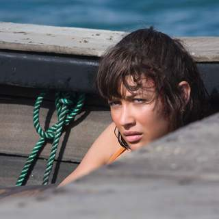 Camille (OLGA KURYLENKO) is forced to board Bond's escape boat in Haiti. Location: Shelter Bay, Colon, Panama. Photo by: Karen Ballard.