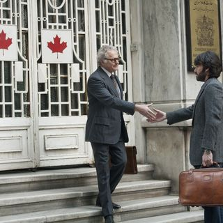 Victor Garber stars as Ken Taylor and Ben Affleck stars as Tony Mendez in Warner Bros. Pictures' Argo (2012)