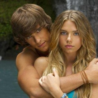Brenton Thwaites stars as Dean McMullen and Indiana Evans stars as Emmaline 'Emma' Robinson in Lifetime's Blue Lagoon: The Awakening (2012)