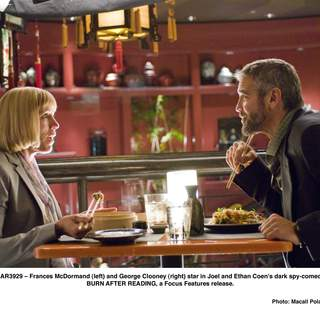 Frances McDormand (left) and George Clooney (right) stars in Joel and Ethan Coen's dark spy-comedy BURN AFTER READING, a Focus Features release.