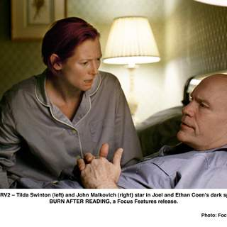 Tilda Swinton (left) and Richard Jenkins (right) star in Joel and Ethan Coen's dark spy-comedy BURN AFTER READING, a Focus Features release.