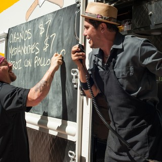 Jon Favreau (stars as Carl Casper) and John Leguizamo in Open Road Films' Chef (2014)