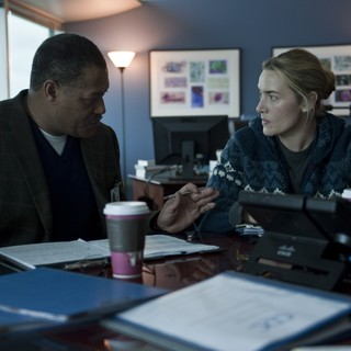 Laurence Fishburne stars as Dr. Ellis Cheever and Kate Winslet stars as Dr. Erin Mears in Warner Bros. Pictures' Contagion (2011)