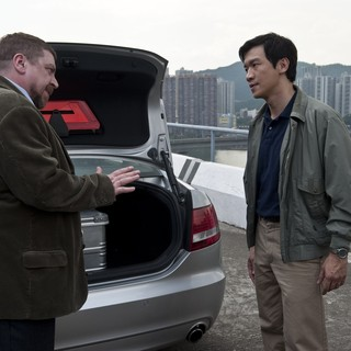 Contagion - Armin Rohde stars as Damian Leopold and Chin Han stars as Sun Feng in Warner Bros. Pictures' Contagion (2011)