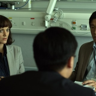 Contagion - Marion Cotillard stars as Dr. Leonora Orantes and Tien You Chui stars as Li Fai in Warner Bros. Pictures' Contagion (2011)