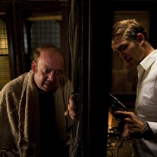 Paul Giamatti stars as Benno Levin and Robert Pattinson stars as Eric Packer in Entertainment One's Cosmopolis (2012)
